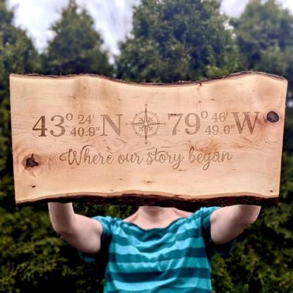 Live edge wood serving board with compass coordinates engraved makes a thoughtful gift.