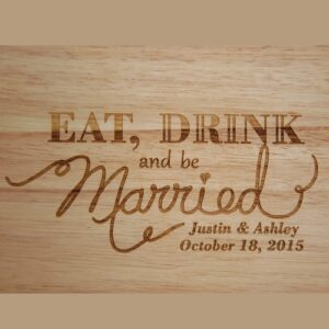 Close up of Eat, Drink and be Married design engraved on a custom cutting board.