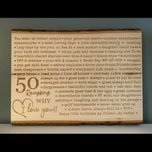 Live edge wall sign with 50 reasons why I love you engraved on it.