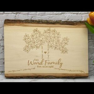 Live edge sign engraved with a family tree including roots.