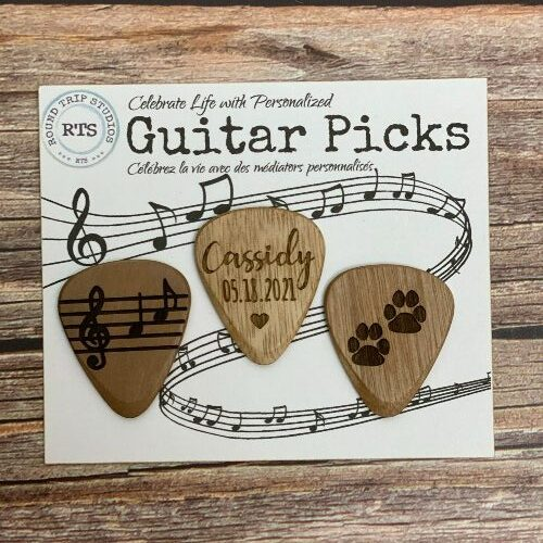 Pack of 3 personalized guitar picks, each with a different saying.