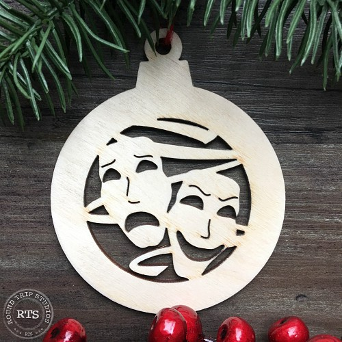 Custom ornament with drama faces cut out.