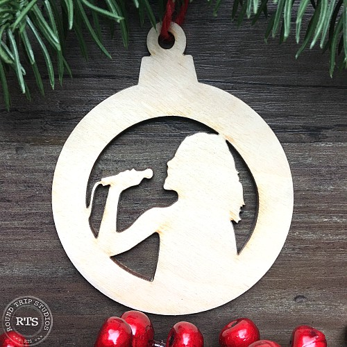 Custom ornament with the silhouette of a long haired singer cut out.