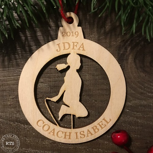 Silhouette of a person skipping cut out from a birch ornament.