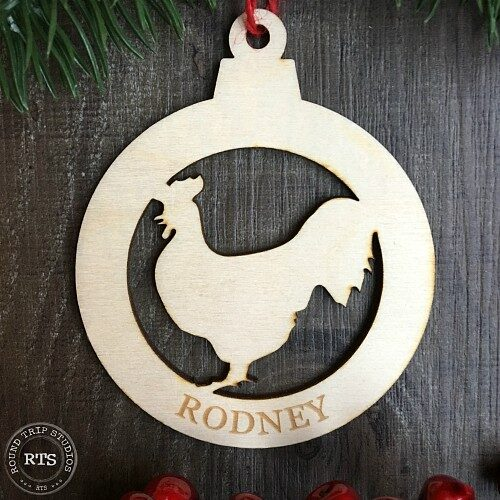 Rooster ornament with silhouette cut from birch wood.