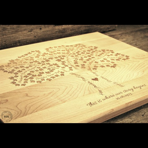 Angled view of a family tree engraved on a Canadian made cutting board.