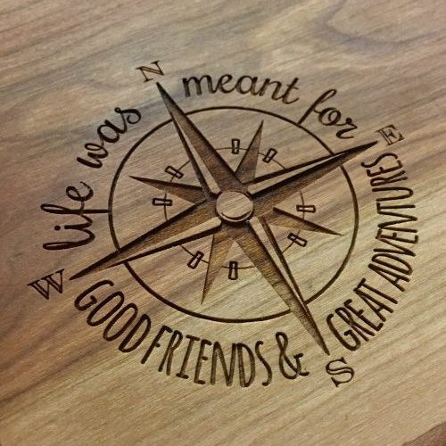 Engraved compass on a live edge charcuterie board.