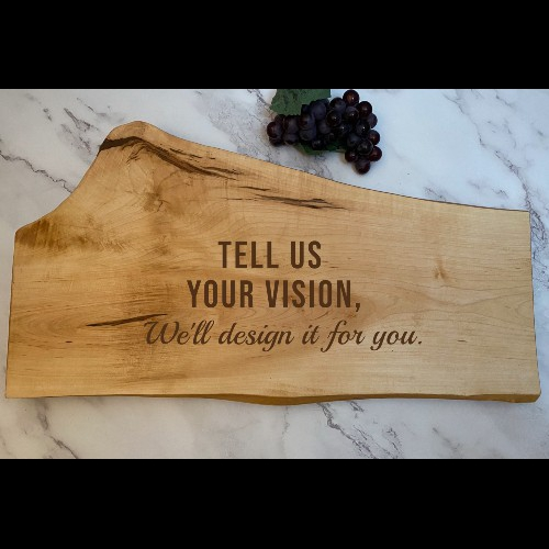Live edge charcuterie board with text overlay saying we can design your vision for you.