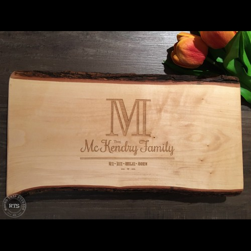 Live edge charcuterie board with initial design engraved.