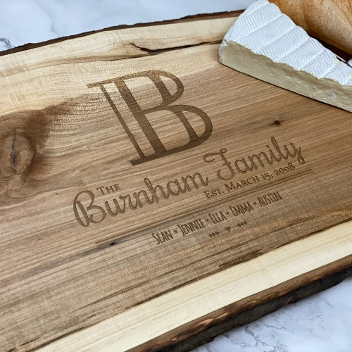 Initial design engraved on a live edge charcuterie board.