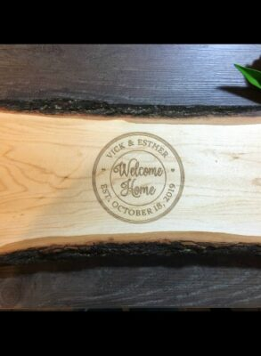 Antipasti board with welcome home engraved in the center circle.