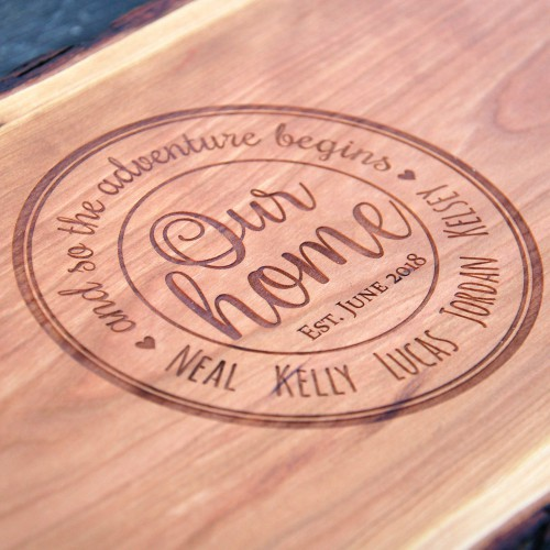 Engraved housewarming gift with our home in the center surrounded by the family members names.