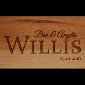 Personalized live edge cutting board with a simple name and date engraved.