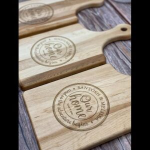 Many paddle style cutting boards with Tuscan our home design personalized to different clients.