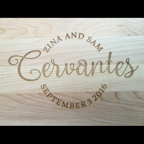 Family name engraved in cursive surrounded by first names and date in block letters.