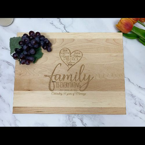 Rectangular cutting board with family design and custom saying engraved in the center.