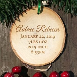 Engrave baby's name and birth statistics on a rustic birch ornament.