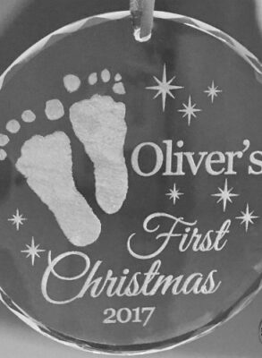 Crystal first Christmas ornament with footprints engraved.