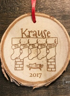 Custom stocking ornament engraved with five names.