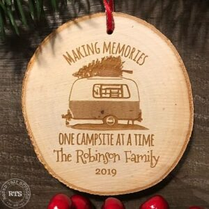 Rustic birch ornament with camper engraved and family name.