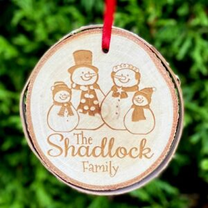 Custom Christmas ornament with a snowman family engraved.