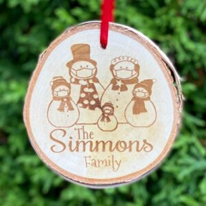 custom 2020 ornament with snowmen family wearing face masks engraved on it.