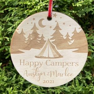 Birch plywood ornament engraved with a camping scene.