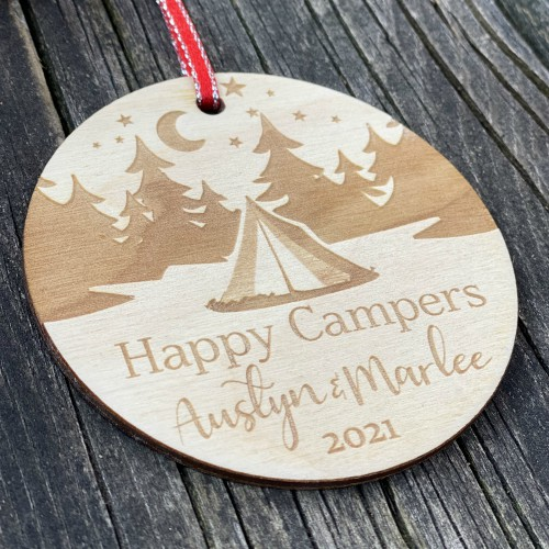 Birch plywood ornament engraved with camping design, side view to show thickness.