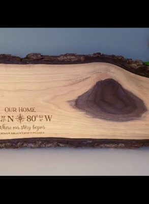 Grazing board with compass coordinates and names engraved.