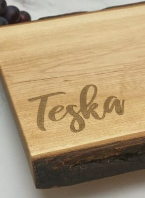 Close up of presentation board with just a name engraved in the corner.