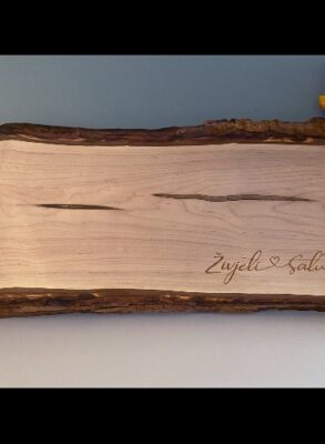 Live edge antipasto board with engraved names connected by a heart.