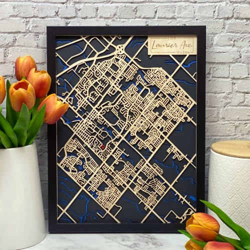 Personalized map of Milton, with streets cut from wood and waterways shown in blue.