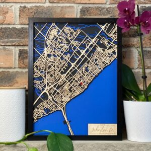 Personalized map of Burlington Ontario with roads cut from wood and waterways shown in blue.