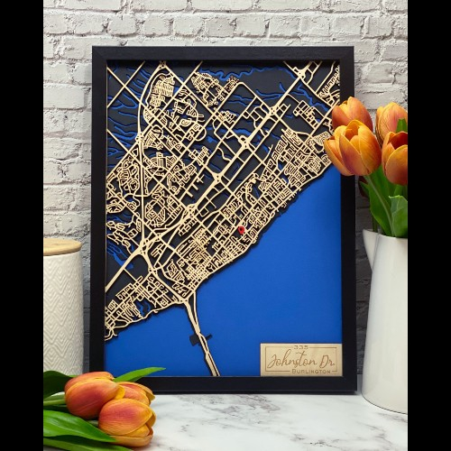 Personalized map of Burlington with the roads made from wood and the waterways showing in blue.
