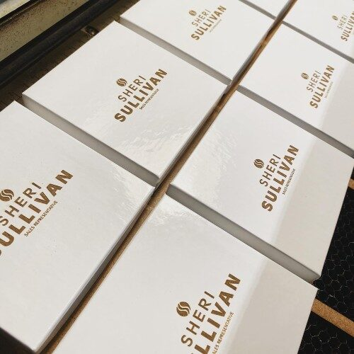 Multiple gift boxes with a logo engraved.