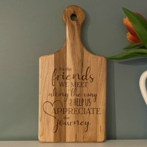 Personalized cutting board with a saying about friendship.