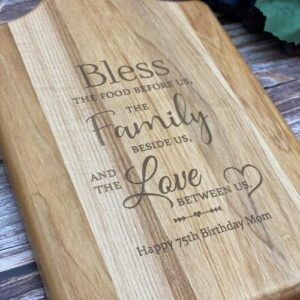 Cutting board made for Mom with bless this food, family and love saying engraved.
