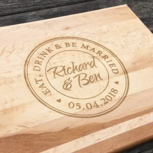 Rectangular cutting board with the Tuscan design engraved in the center of the board.