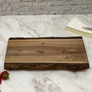 Walnut board with Happily Ever After engraved on it.