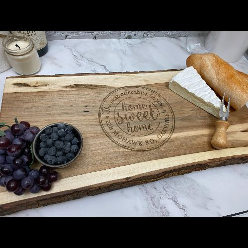 Live edge charcuterie board personalized for a housewarming gift.