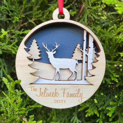 Custom reindeer Christmas ornament made with layered wood.