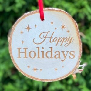 Happy Holidays engraved on a rustic birch ornament.