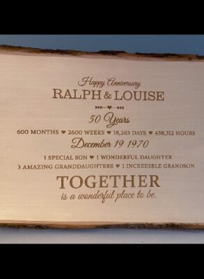 Custom engraved anniversary sign on a live edge board.